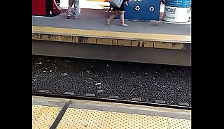 Midget with blindfold hands across platform