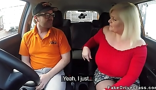 Beamy mature fucks in driving school car