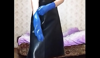 Person in leather apron putting on different gloves